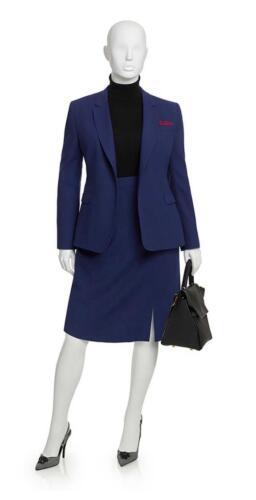 Vrouwelijk mantelpak met rok en colbert in blauw