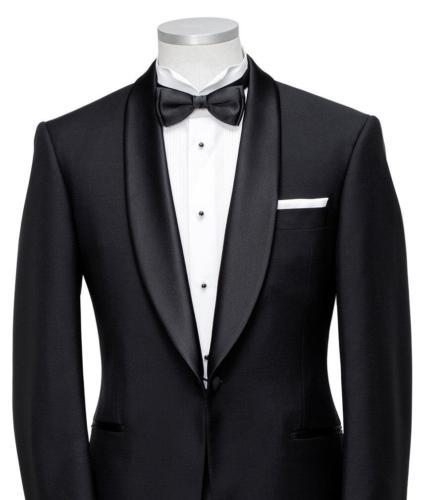 Zwarte smoking met wit smoking overhemd met pique en zwarte studs